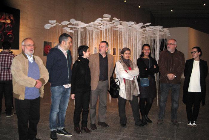 Foto de familia de los comisarios, el director del Musac y algunas artistas africanas participantes.
